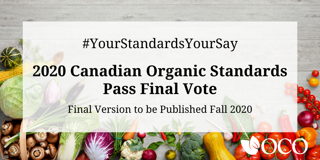 Text reads #YourStandardsYourSay. Canadian Organic Standards Passes Final Vote. Final version to be published fall 2020. Background image shows colourful fruits and vegetables.